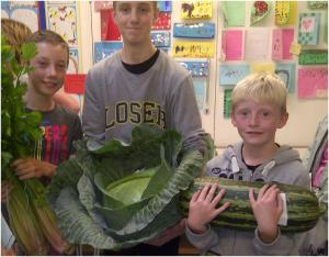 Ronan , Aaron and Nathan with their giant veg buys